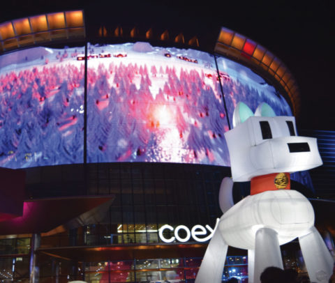 LED screen facade building with dog