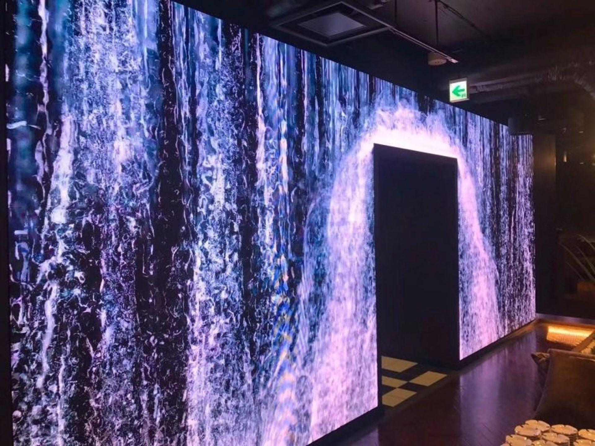 Digital video wall display of waterfall in lobby