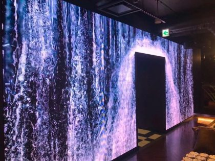 Digital video wall display of waterfall in lobby