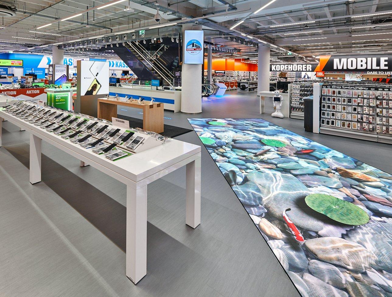 Saturn Store interactive floor POS